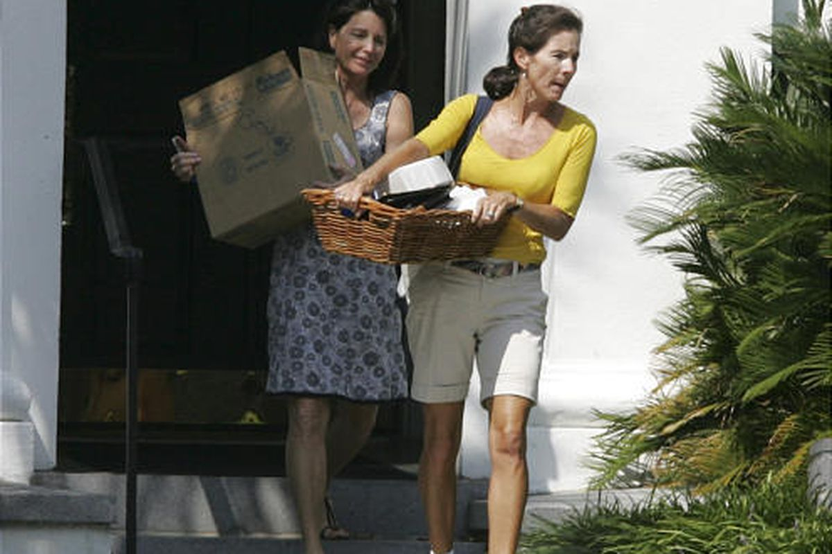 Jenny Sanford, right, and a friend carry her belongings from the Governor's Mansion. Jenny Sanford said she'd keep up her first lady duties.