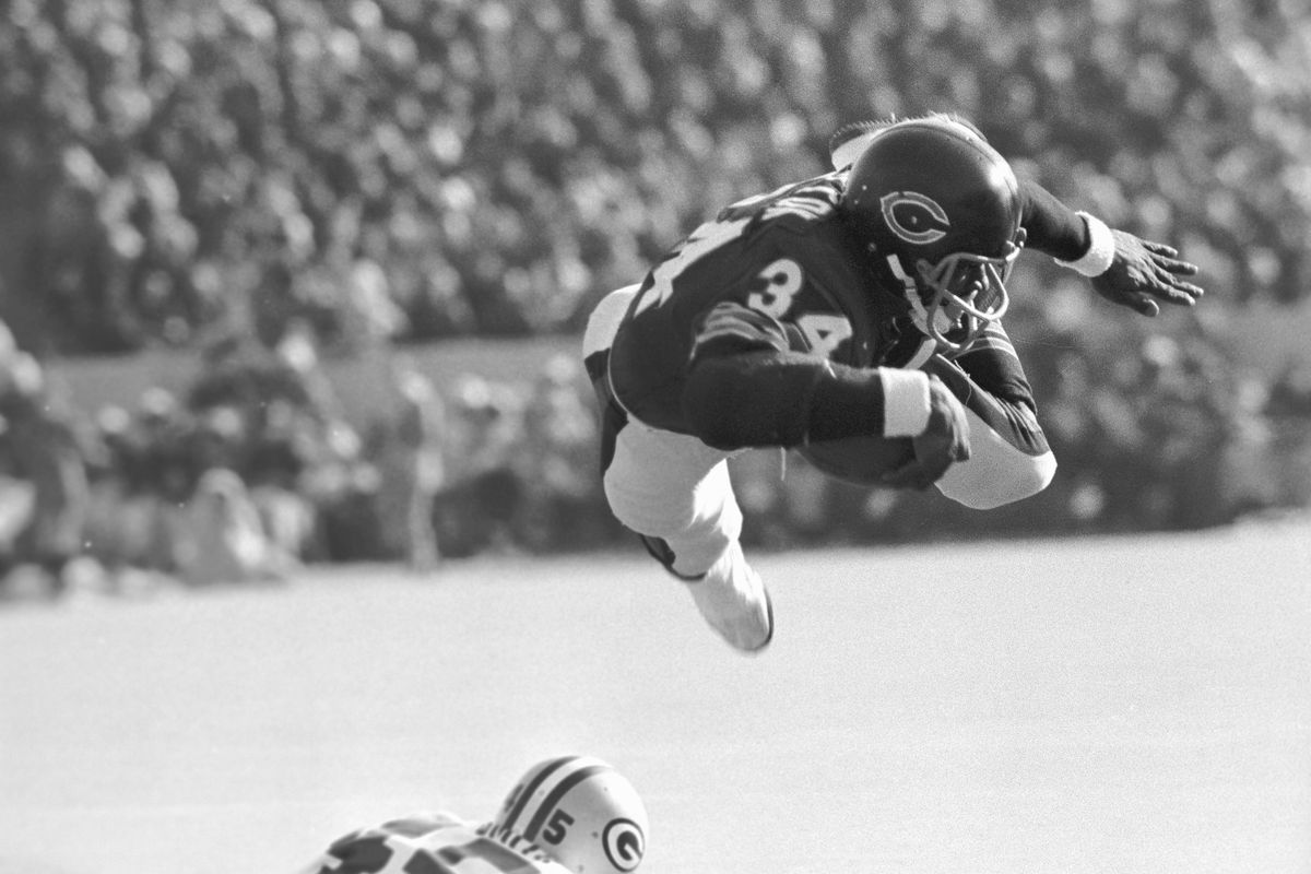 Walter Payton in Mid-Leap With Football