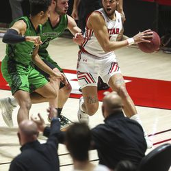 Utah Utes forward Timmy Allen (1) gets trapped in the corner by the UVU defense during a game at the Huntsman Center in Salt Lake City on Tuesday, Dec. 15, 2020.