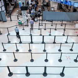 Only a few people stand in line for the security checkpoint in Terminal 1 at Salt Lake City International Airport on Thursday, April 30, 2020. Like airports all over the world, Salt Lake's airport has seen air traffic plummet due to the COVID-19 pandemic.