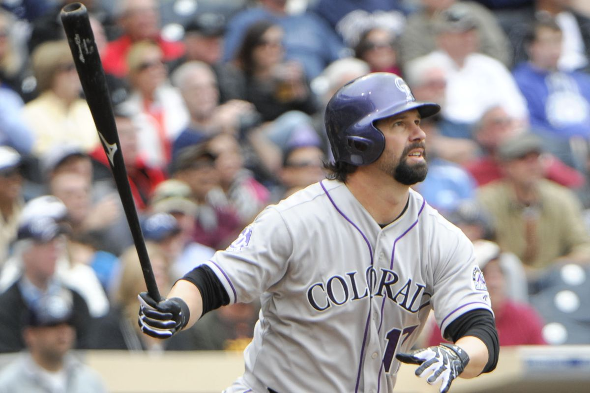 Todd Helton watches the flight of his two-run HR in the seventh inning on Sunday.