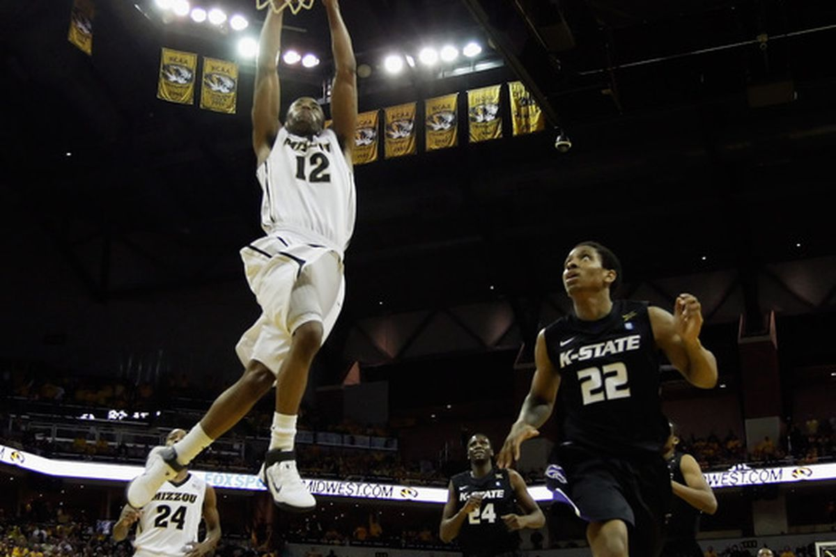 COLUMBIA MO - JANUARY 17:  Marcus Denmon #12 of the Missouri Tigers dunks against Rodney McGruder #22 and the Kansas State Wildcats during the game on January 17 2011 at Mizzou Arena in Columbia Missouri.  (Photo by Jamie Squire/Getty Images)