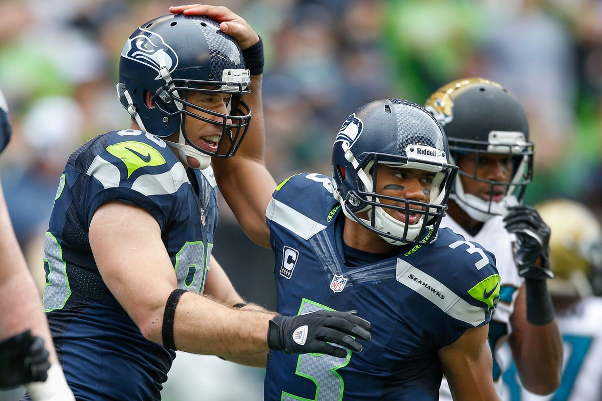Russell Wilson celebrates as the Seahawks go 3-0