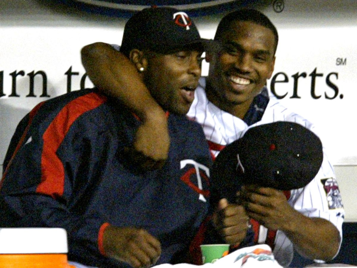 Marlin Levison - Strib 09/16/05 - Assign#95177- Twins vs. White Sox baseball. IN THIS PHOTO: Torii Hunter, left is welcomed back to the dugout by his buddy Jacque Jones after Jones hit a one-run home run in the 4th inning. Hunter has been on DL with an