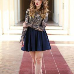 "Lillian of <a href=""http://www.studsandsapphires.com""target=""_blank"">Studs and Sapphires</a> is wearing a For Love & Lemons shirt, an H&M skirt and Steve Madden shoes."