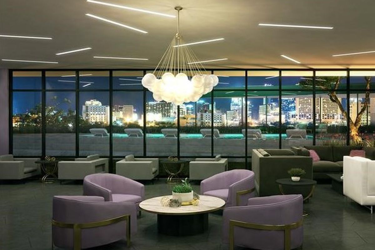 Rendering of a common area/lounge, dark with a statement chandelier and view of a pool/downtown