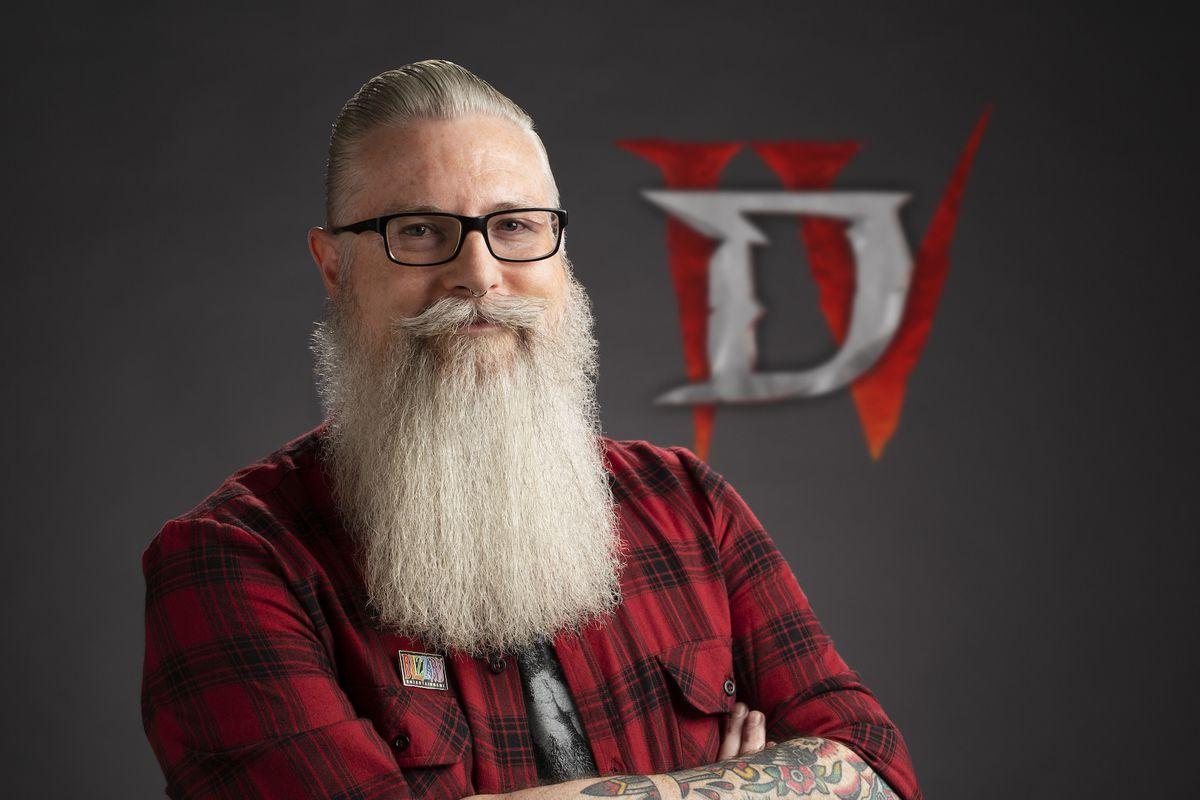 A photo of developer Jesse McCree in front of a Diablo 4 logo