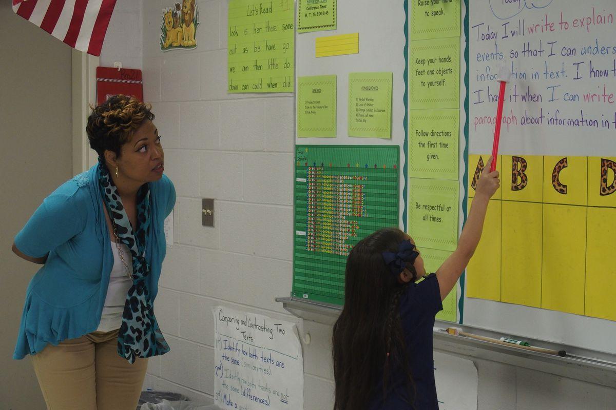 Memphis teacher Tanya Hill encourages a student at Kate Bond Elementary School.