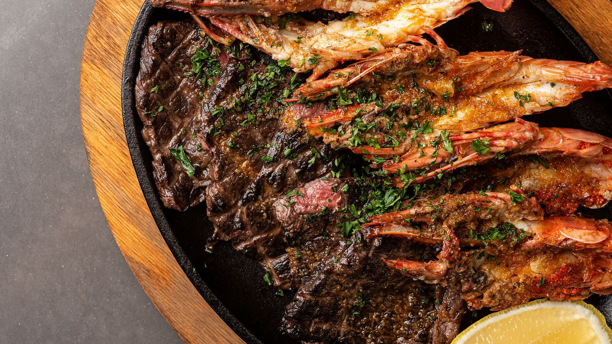 Grilled Basque steak and prawns from Buho Rouge in Pasadena on a platter.