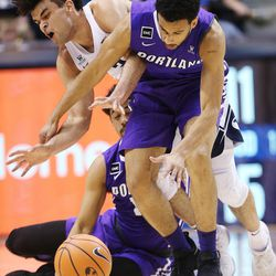 Brigham Young Cougars guard Elijah Bryant (3) collides with Portland Pilots guard D'Marques Tyson (5) in Provo on Thursday, Dec. 28, 2017.
