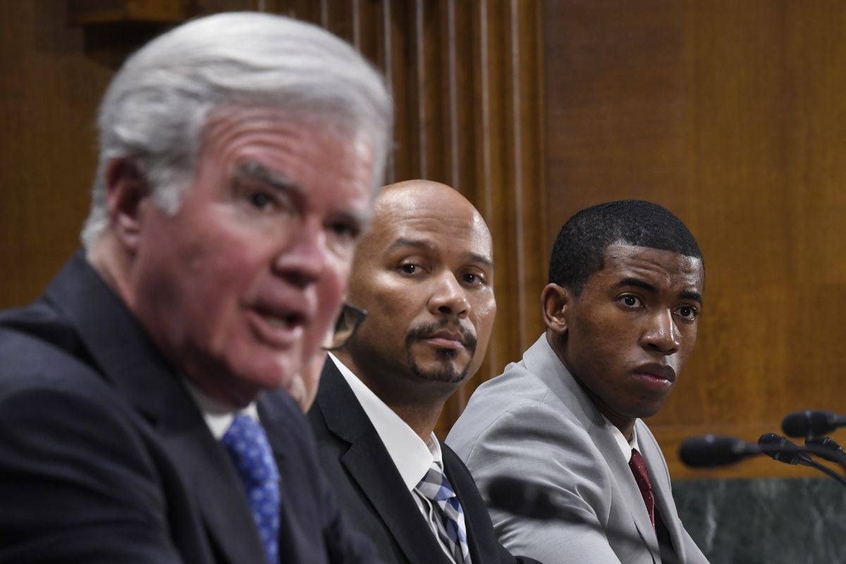 National Collegiate Athletic Association Student-Athlete Advisory Committee Chair Kendall Spencer, right, and National College Players Association Executive Director Ramogi Huma, center, listen as NCAA President Mark Emmert, left, testifies during a Senate Commerce subcommittee hearing on intercollegiate athlete compensation.