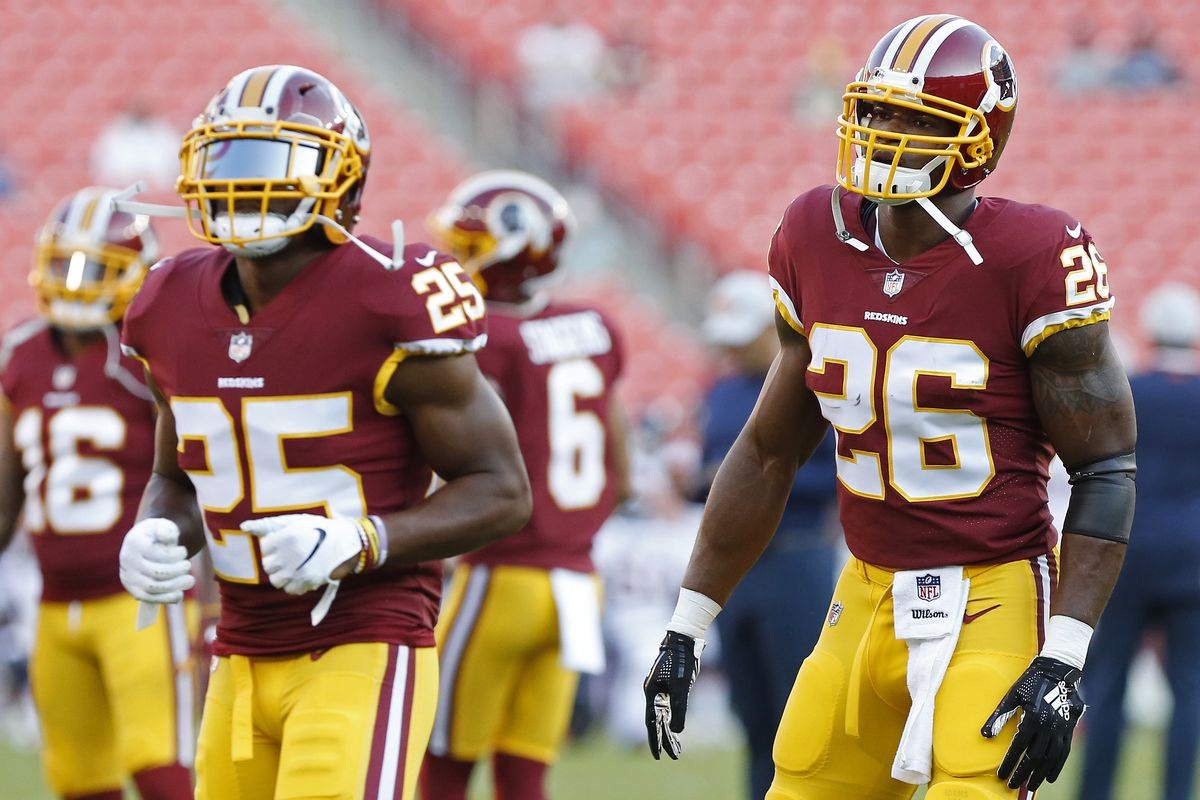 Washington running back Adrian Peterson and running back Chris Thompson participate in warm-ups prior to the Redskins' game against the Denver Broncos at FedEx Field.