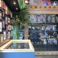 Gallery of famous faces wearing Nialaya above a gilded display case