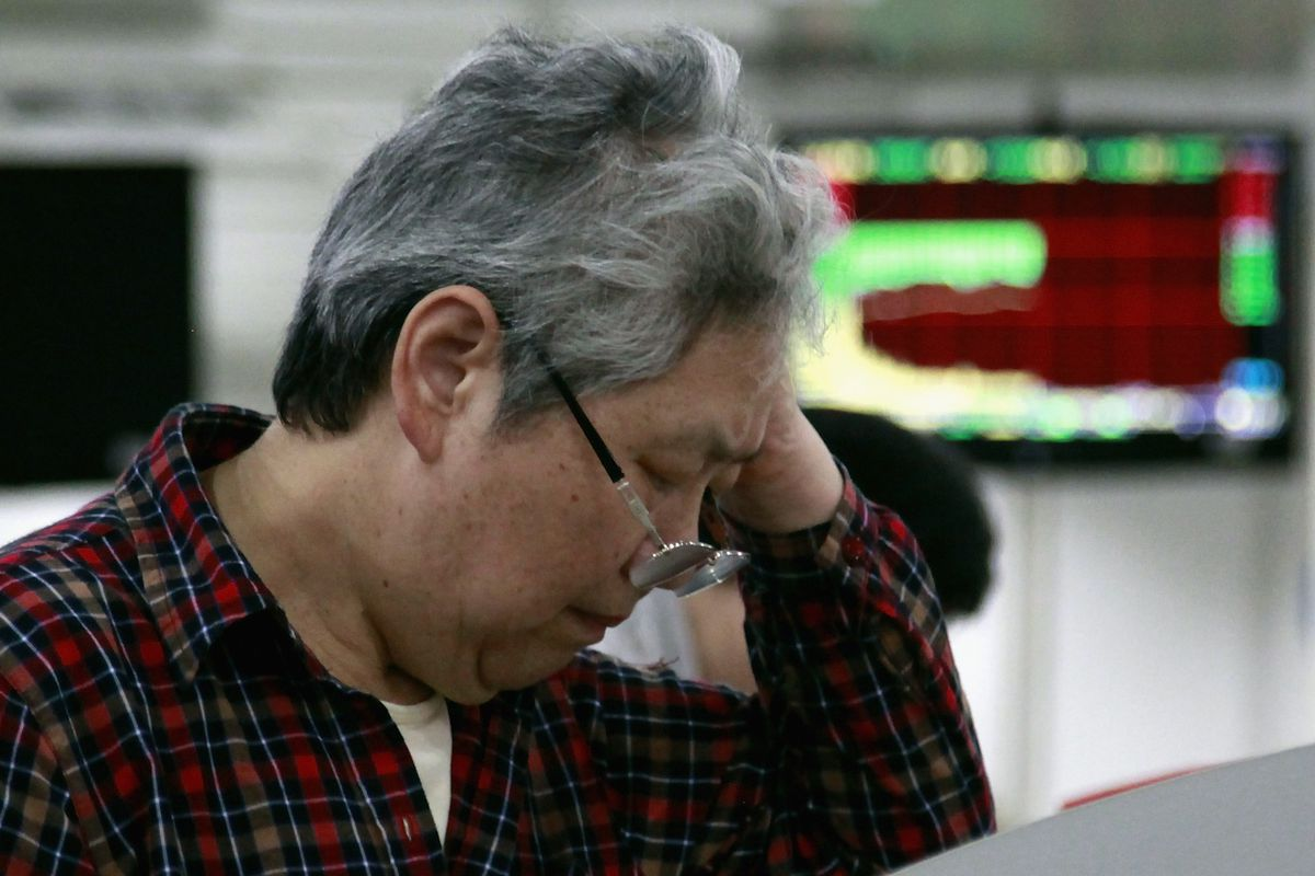An investor looks at stock index quotes inside a brokerage firm on July 8, 2015 in Shanghai, China.
