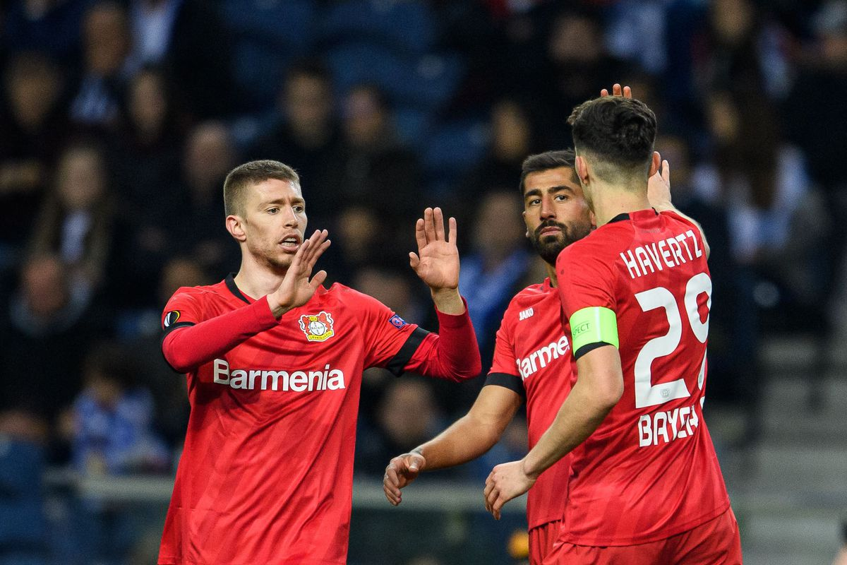 Mitchell Weiser, Kerem Demirbay and Kai Havertz of Leverkusen celebrating their teams second goal during the UEFA Europa League round of 32 second leg match between FC Porto and Bayer 04 Leverkusen at Estadio do Dragao on February 27, 2020 in Porto, Portugal.