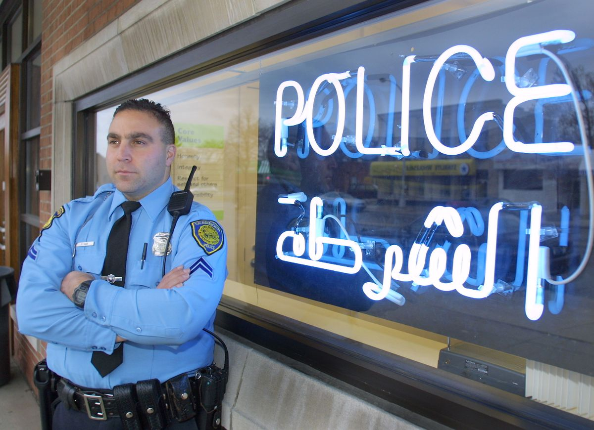 police sign arabic