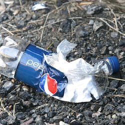 A mangled, plastic Pepsi bottle - the remnants of a homemade chemical bomb - lies on the ground during a demonstration by the Salt Lake Police Department's Bomb Squad Tuesday. The demonstration was aimed at raising awareness of the dangers associated with homemade dry-ice and chemical bombs.