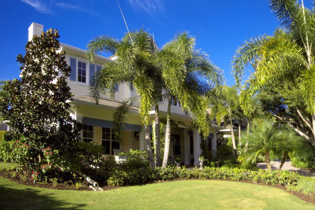 A lush Southern-style Florida home's entrance
