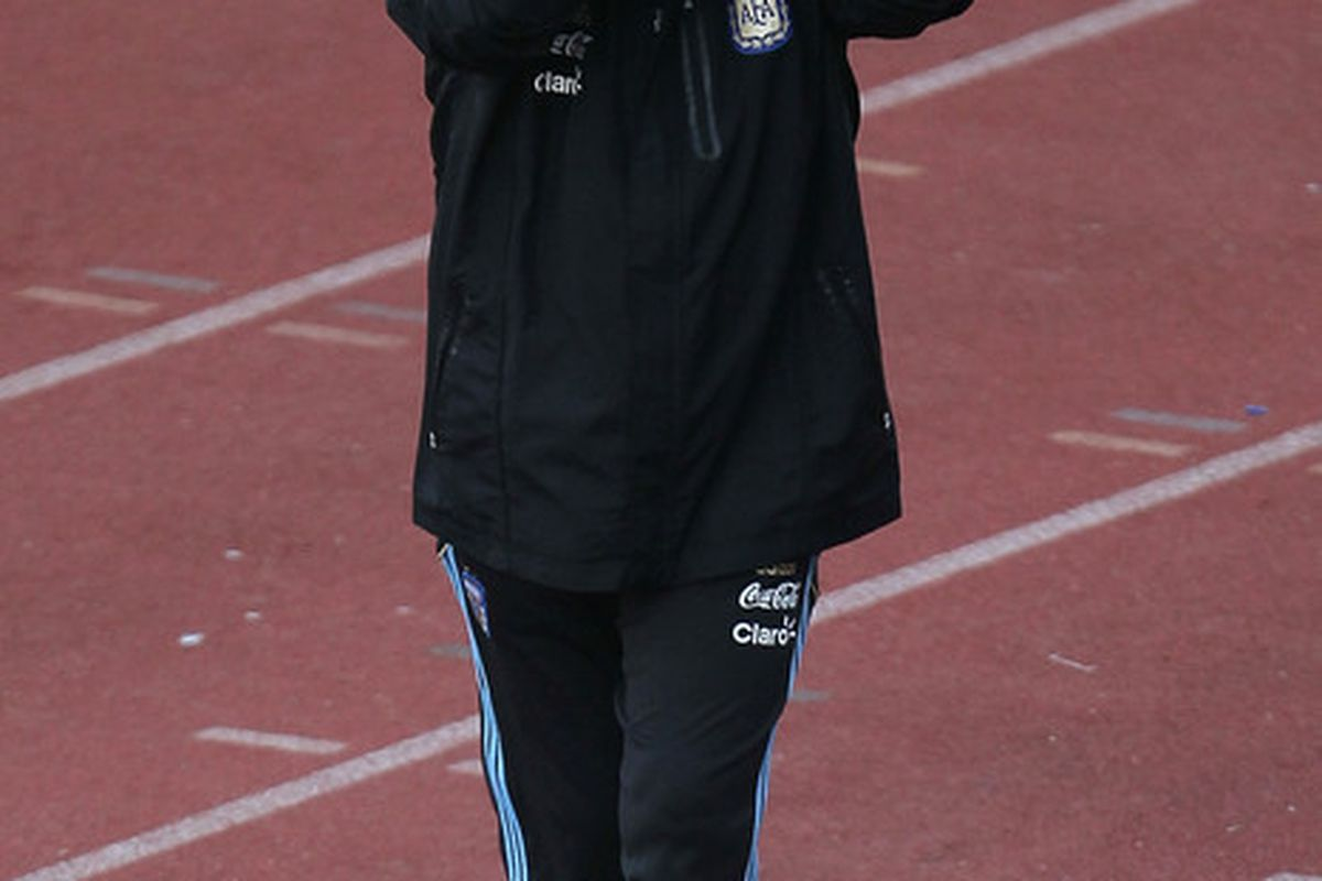 PRETORIA, SOUTH AFRICA - JUNE 06:  Argentina's head coach Diego Maradona waves to the crowd during a team training session on June 6, 2010 in Pretoria, South Africa.  (Photo by Chris McGrath/Getty Images)