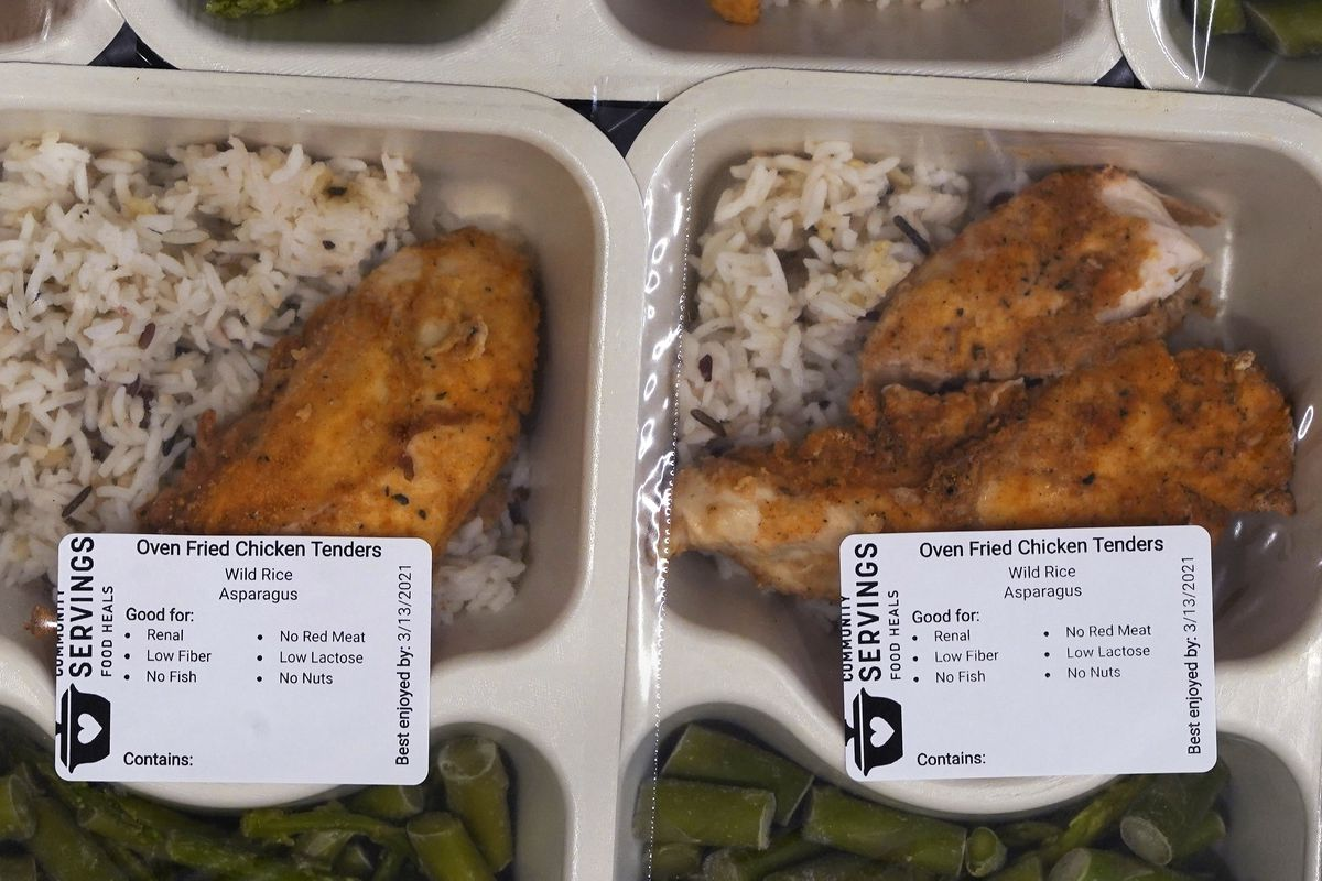 Freshly made meals, with dietary labels, are packaged for clients at Boston-based Community Servings, which prepares and delivers medically tailored meals to people with critical and chronic illnesses.