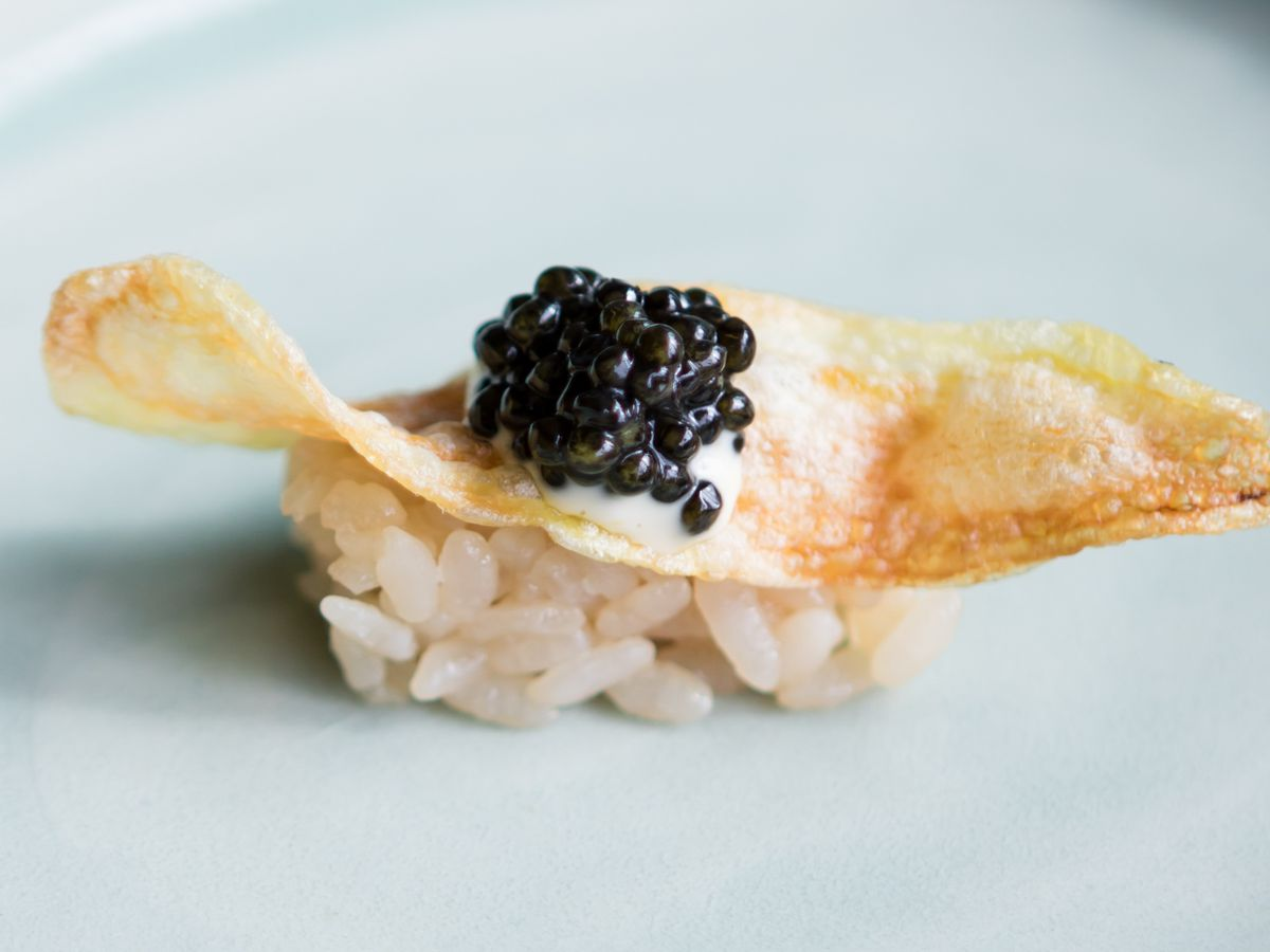 A potato chip caviar sushi dish at Robin