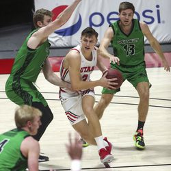 Utah Utes guard Pelle Larsson (3) drives into the UVU defense during a game at the Huntsman Center in Salt Lake City on Tuesday, Dec. 15, 2020.