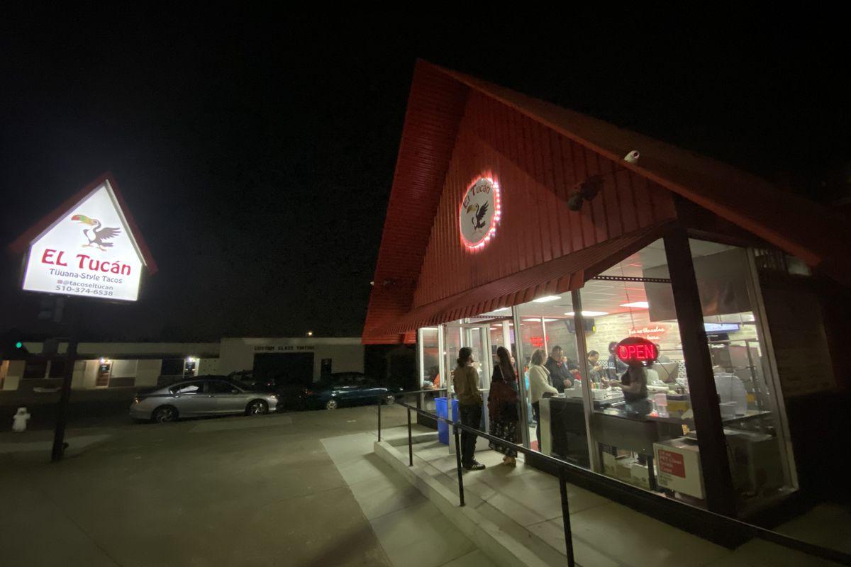 Exterior shot of Tacos El Tucan at nighttime