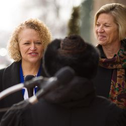 Jackie Biskupski, left, with fiancÉe Betty Iverson, is sworn in as Salt Lake City's first openly gay mayor during a ceremony outside the City-County Building on Monday, Jan. 4, 2016.