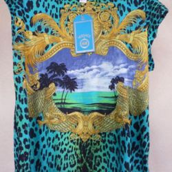 """This tee <a href=""""http://www.ebay.com/itm/Versace-H-M-sz-M-Top-NWT-VIP-Bonuses-/220896926178?pt=US_CSA_WC_Shirts_Tops&hash=item336e7b99e2"""" rel=""""nofollow"""">costs $56.99</a> and comes with a 20 minute DVD """"highlight reel"""" from Prince's performa"""