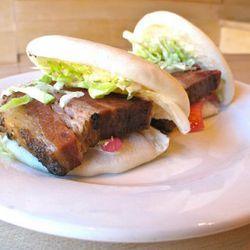 "Momofuku Noodle Bar brisket buns by <a href=""http://www.flickr.com/photos/dereklo/5572634848/in/pool-eater/"">dlothebigasian</a>."