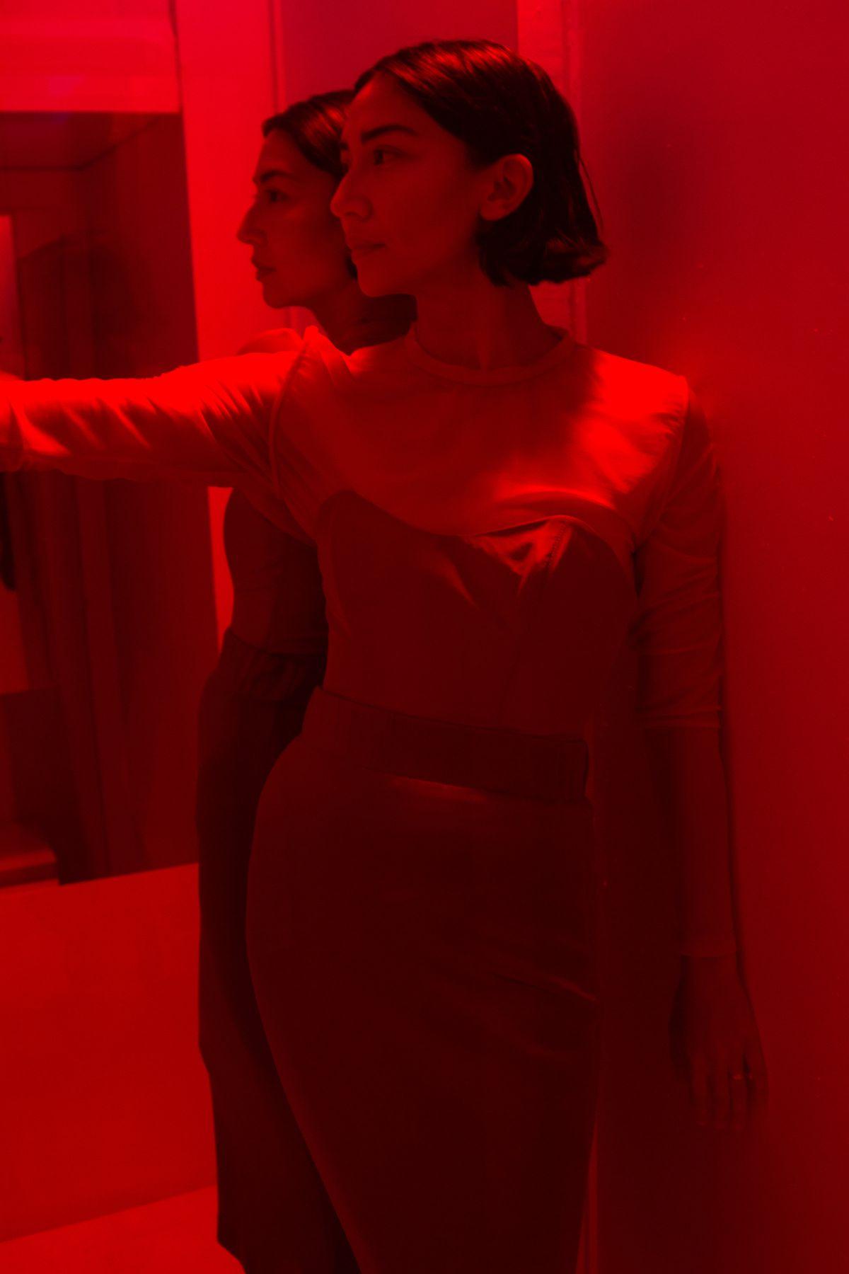 Designer Suzanne Rae inside a mirrored box at her fashion week presentation.