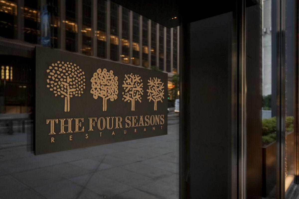 The Four Seasons logo with four trees
