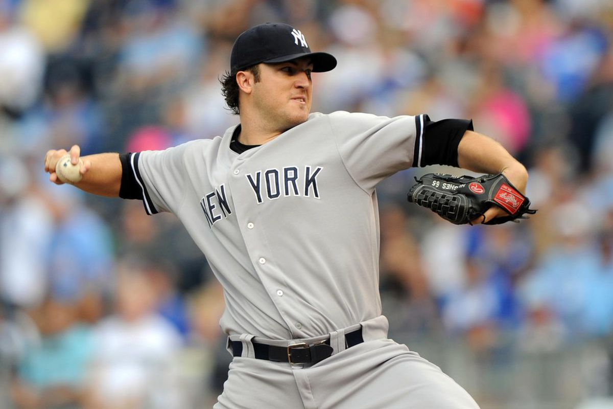 May 6, 2012; Kansas City, MO, USA; New York Yankees pitcher Phil Hughes (65) delivers a pitch against the Kansas City Royals during the first inning at Kauffman Stadium.  Mandatory Credit: Peter G. Aiken-US PRESSWIRE