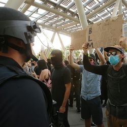 A large group of demonstrators chant and yell at police officers at the Public Safety Building in Salt Lake City on Monday, June 1, 2020.