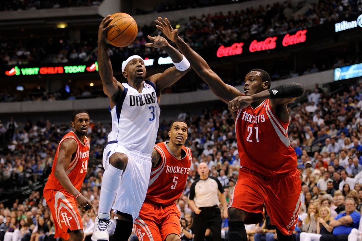 Apr 18, 2012; Dallas, TX, USA; Dallas Mavericks shooting guard Jason Terry (31) is fouled by Houston Rockets center Samuel Dalembert (21) during the second quarter at the American Airlines Center. Mandatory Credit: Jerome Miron-US PRESSWIRE