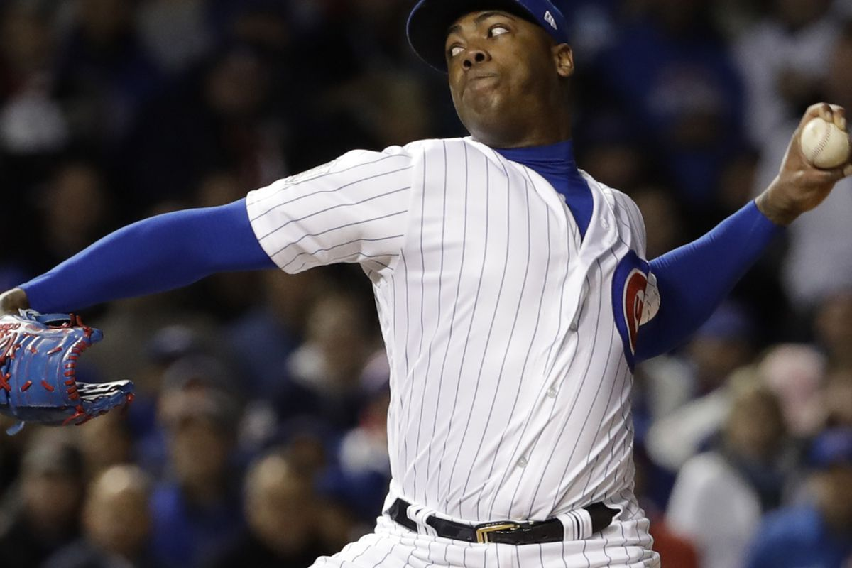 113dbac67 FILE - This Oct. 30, 2016 file photo shows Chicago Cubs relief pitcher Aroldis  Chapman throwing during the seventh inning of Game 5 of the Major League ...
