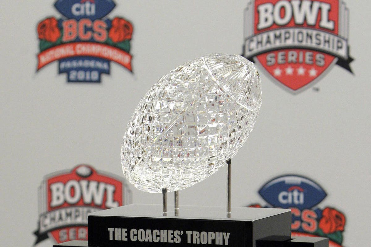 FILE - In this Jan. 5, 2012, file photo, the BCS Coaches' Trophy is displayed during a media availability on Newport Beach, Calif. A tentative plan for the new college football postseason calls for a Pac-12 or Big 12 team to face the best team from a grou