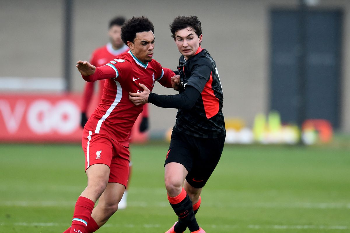 Trent Alexander-Arnold and Mateusz Musialowski of Liverpool during a training session at AXA Training Centre on March 20, 2021 in Kirkby, England.