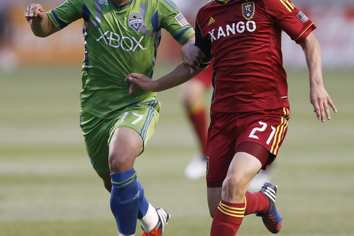 SANDY, UT - JULY 4: Luis Gil #21 of Real Salt Lake and Fredy Montero #17 of the Seattle Sounders chase the ball down during the first half of an MLS soccer game July 4, 2012 at Rio Tinto Stadium in Sandy, Utah.(Photo by George Frey/Getty Images)