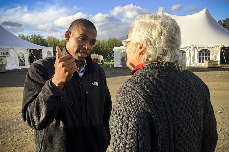 Congressional candidate Antonio Delgado talks with a potential voter while campaigning in Schodack Landing, N.Y., on October 13, 2018.