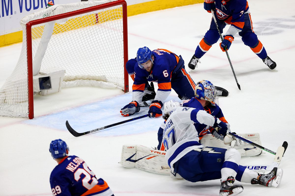 Ryan Pulock #6 of the New York Islanders blocks a shot by Ryan McDonagh #27 of the Tampa Bay Lightning during the third period in Game Four of the Stanley Cup Semifinals during the 2021 Stanley Cup Playoffs at Nassau Coliseum on June 19, 2021 in Uniondale, New York.