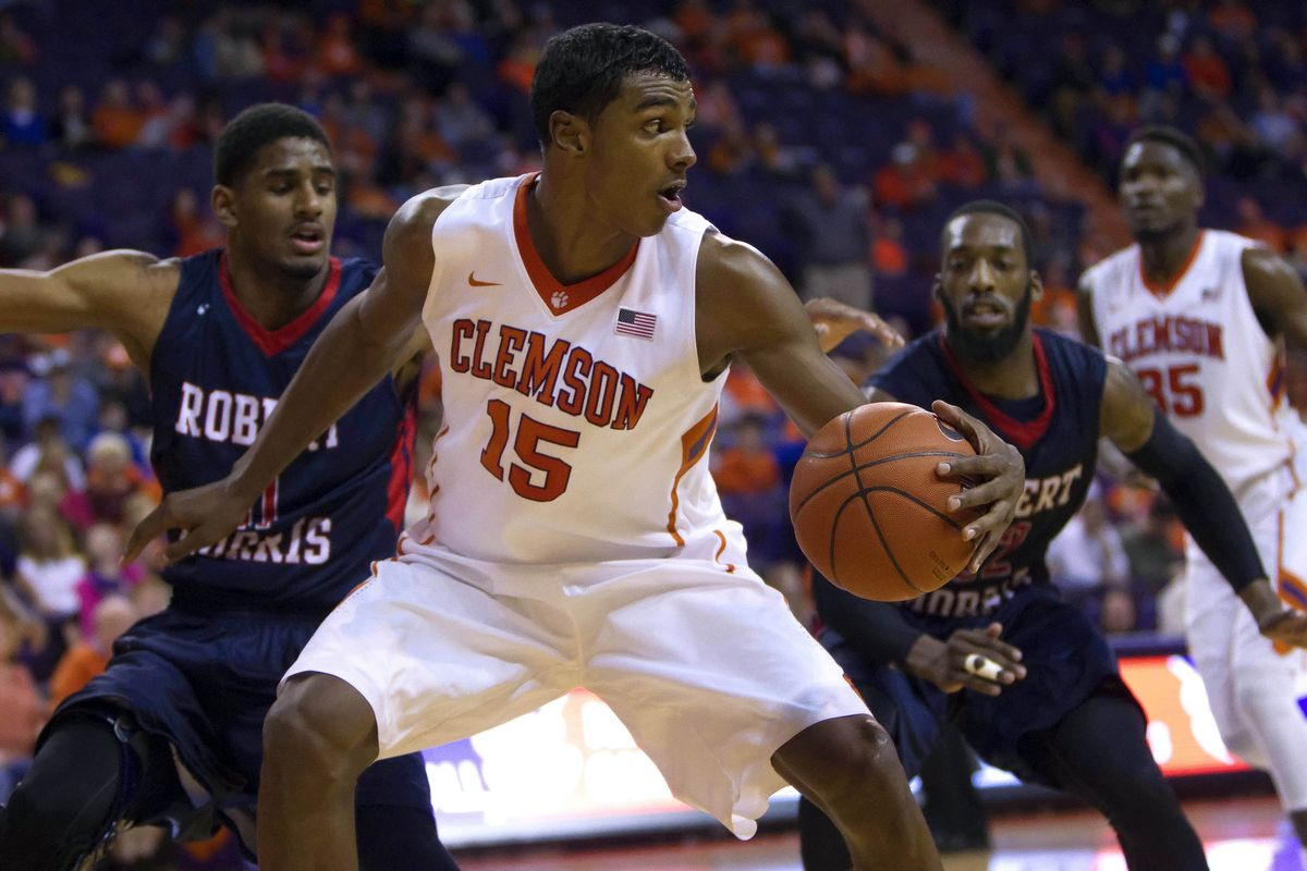 Dec 30, 2014; Clemson, SC, USA; Clemson Tigers forward Donte Grantham (15) looks to pass the ball while being defended by Robert Morris Colonials guard Rodney Pryor (11) and guard Lucky Jones (22) during the second half at Littlejohn Coliseum.