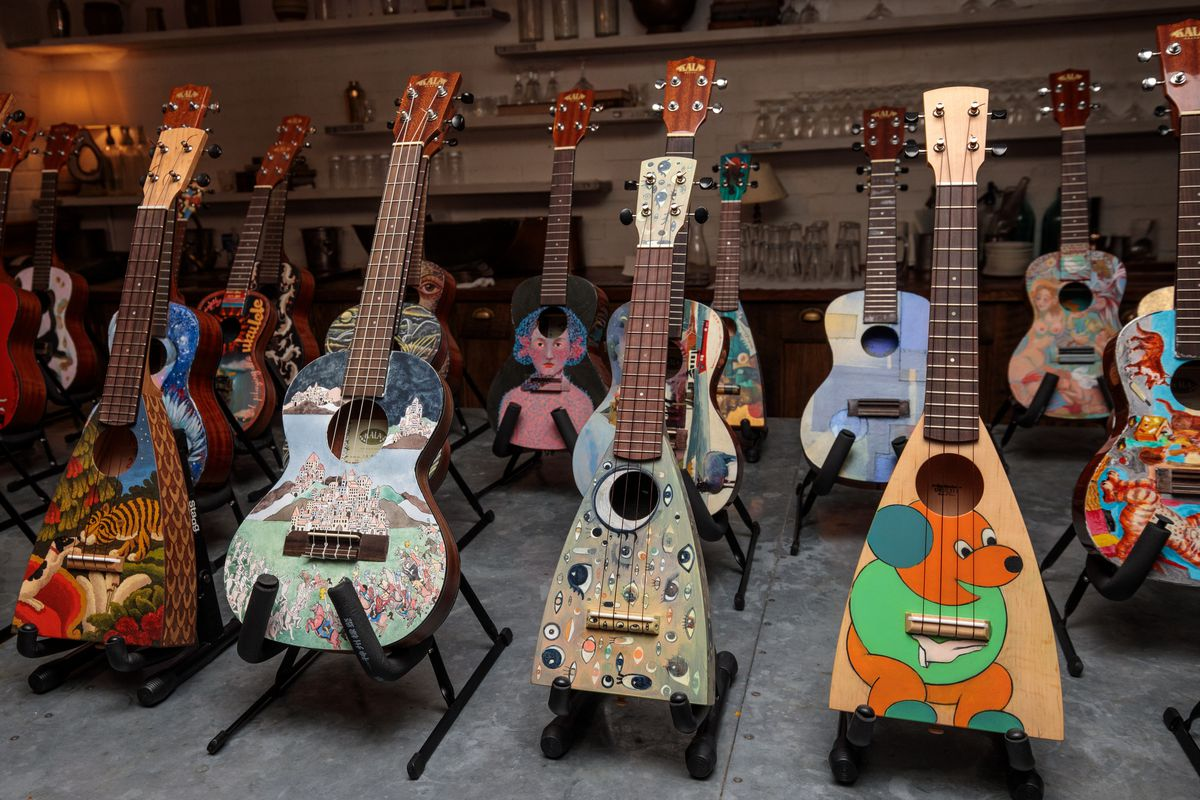 Decorated Instruments Belonging To The Ukulele Orchestra of Great Britain Are Displayed Ahead Of Charity Concert