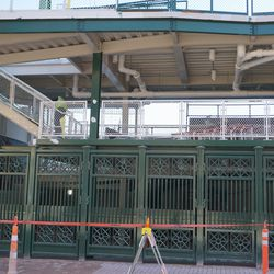 Underneath the new extension in the left field bleacher corner