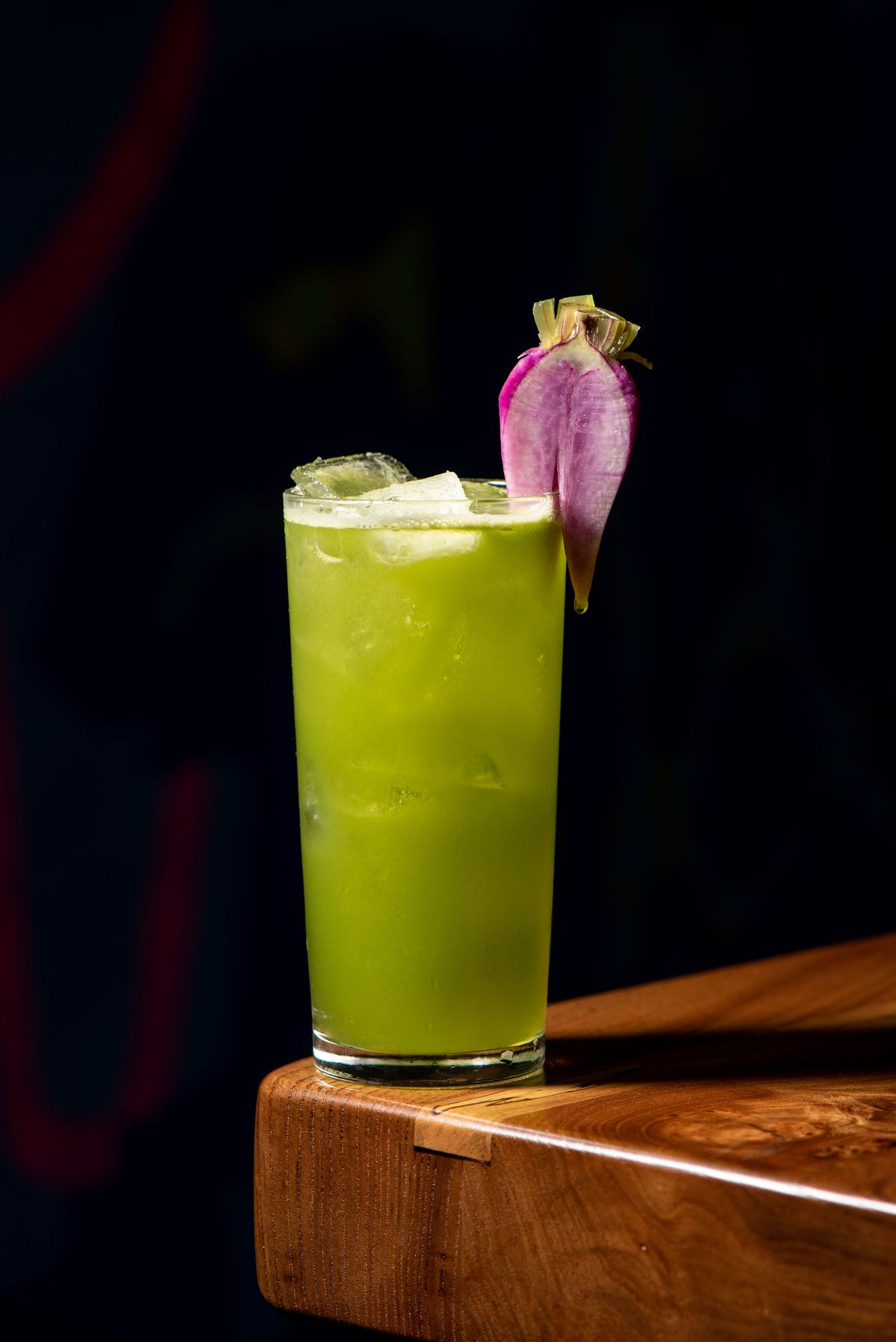 A tin, tall cocktail with light lime green shades.