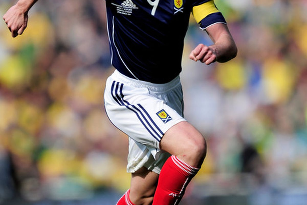LONDON, ENGLAND - MARCH 27: Kenny Miller of Scotland runs with the ball during the International friendly match between Brazil and Scotland at Emirates Stadium on March 27, 2011 in London, England.  (Photo by Jamie McDonald/Getty Images)