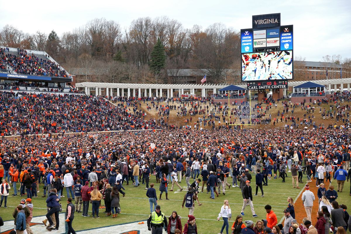 Fans of the Virginia Cavaliers rush the field after defeating the Virginia Tech Hokies during a game at Scott Stadium on November 29, 2019 in Charlottesville, Virginia.
