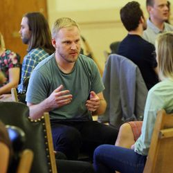 Lee Hale talks to other attendees as they take part in discussion lead by Thomas McConkie of Lower Lights in Salt Lake City on Wednesday, June 14, 2017.