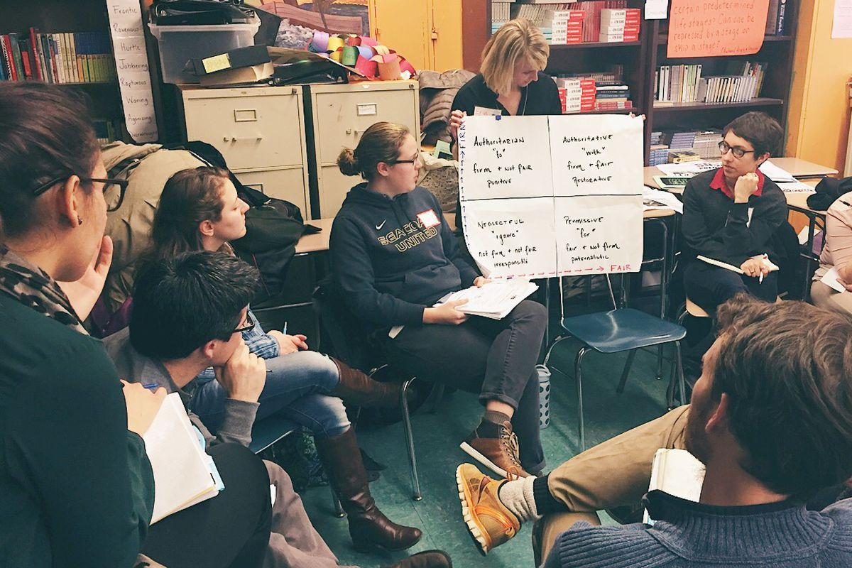 The author, sitting to the left of sign, at a Teachers Unite workshop for educators on restorative justice in 2015.