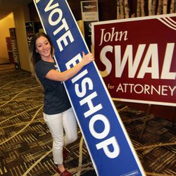Jennifer Lowe carries a Rob Bishop sign  at the Hilton  in Salt Lake City  Tuesday, Nov. 6, 2012.
